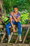 Young African American Man traveling, relaxing at Central Park, Royalty Free Stock Photos