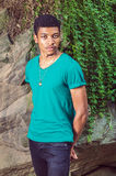 Young African American Man traveling, relaxing at Central Park, Stock Photography