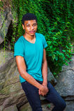 Young African American Man traveling, relaxing at Central Park, Royalty Free Stock Image