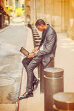 Young African American Man traveling, working on vintage street Stock Image