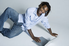 Young African American man using laptop Stock Photos