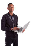 Young african american man using a laptop Stock Images