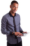 Young african american man using a tablet pc Stock Photography