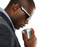 Young African American Man with vintage microphone. Isolated on a white background Stock Photos