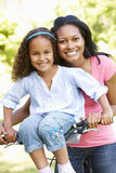 Young African American Mother And Daughter Cycling In Park royalty free stock photos