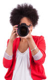 Young african american  photographer with camera Royalty Free Stock Image