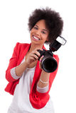 Young african american  photographer with camera Stock Photos