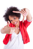 Young african american  photographer making frame gesture with t Stock Photo