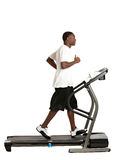 Young African American Running Treadmill Royalty Free Stock Photos