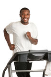 Young African American Running Treadmill Stock Photo