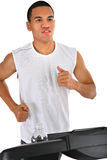 Young African American Running in Treadmill Royalty Free Stock Images