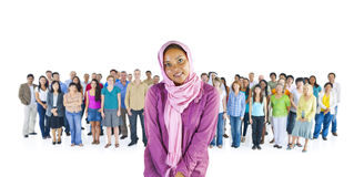 Young African American standing out from the crowd Stock Photos