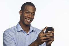 Young African American taking a picture with smartphone, horizontal Royalty Free Stock Images