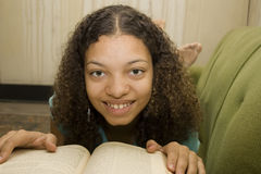 Young African American Teen Reading royalty free stock images
