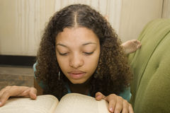 Young African American Teen Reading Stock Photo