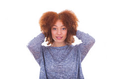 Young african american  teenage girl holding her curly hair isol Royalty Free Stock Photo