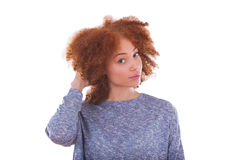 Young african american  teenage girl holding her curly hair isol Royalty Free Stock Images