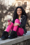 Young african american teenage girl listenin Stock Images