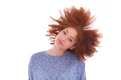 Young african american  teenage girl playing with her curly hair Stock Photo