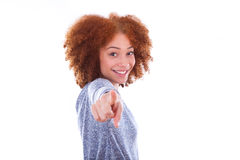 Young african american teenage girl pointing finger to the scree Royalty Free Stock Photography