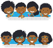 Young African American teens having fun in outdoor swimming pool. Cheerful girls and boys relaxing and drinking cocktails in the pool. Young African American Stock Photos