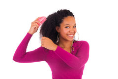Young african american woman combing hair stock photography
