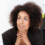 Young African American woman daydreaming Stock Image