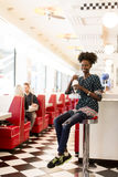 Young african american woman in the diner Royalty Free Stock Photo
