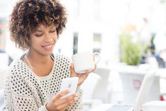 Young african american woman drinking coffee. royalty free stock image