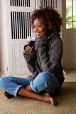 Young african american woman enjoying a glass of wine Stock Images