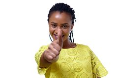 Young African American woman giving thumb up royalty free stock photos