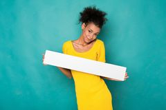 Young african-american woman holding blank banner royalty free stock images