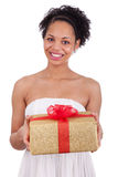 Young African American woman holding a gift Stock Photos
