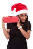 Young African American woman holding gift box Royalty Free Stock Images