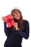 Young African American woman holding gift box Stock Photos