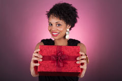 Young African American woman holding a gift Royalty Free Stock Image
