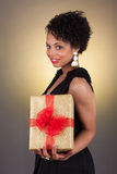 Young African American woman holding a gift Stock Photo