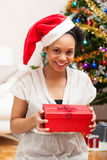 Young African American woman holding a gift box - Black people Royalty Free Stock Images
