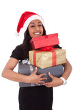 Young African American woman holding gift boxes Stock Photography