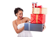 Young African American woman holding gifts boxes Stock Images