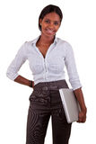 Young African American woman holding a laptop Stock Image