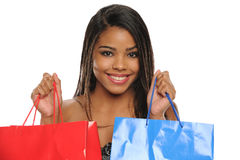 Young African American Woman holding shopping bags Royalty Free Stock Images