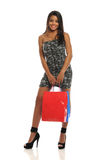 Young African American Woman holding shopping bags Stock Photography