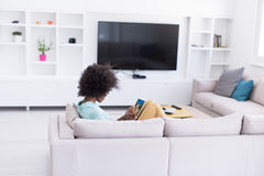 African american woman at home using digital tablet Stock Photo