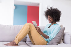 African american woman at home using digital tablet Stock Image