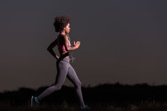 Young African american woman jogging in nature royalty free stock photography