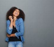 Young african american woman laughing on gray background Royalty Free Stock Photography