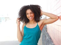 Young african american woman laughing outdoors Stock Photo