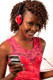 Young African American woman listening to music with headphones. Pretty young African American woman with headphones listening to music stock photo