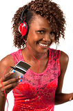 Young African American woman with headphones. Pretty young African American woman with headphones dancing to music. Smiling at the camera stock photos